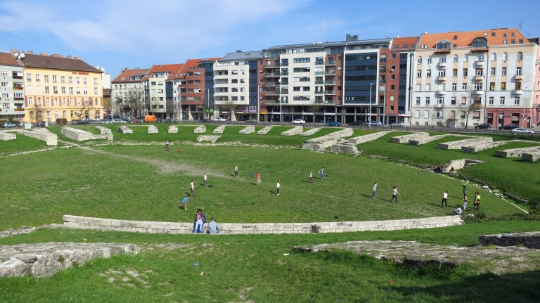 The local youth is playing baseball, where romans were playing as well, twothousand years ago